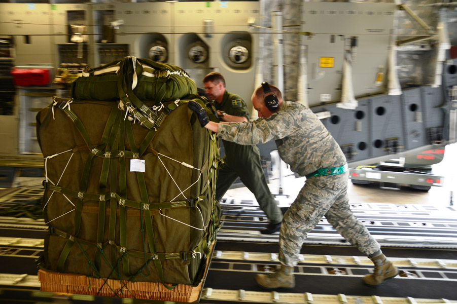 SAC C-17 is loaded with Container Delivery System Pallets